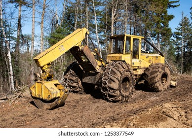 Town of Lake Pleasant, NY - October 26, 2018:  A John Deere 548G grapple skidder parked on a muddy log landing in the Adirondack Mountains NY.