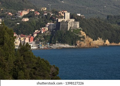 The town of Lerici and its castle overlooking the sea of Liguria. Near the Cinque Terre the country of Lerici and the castle. The green Mediterranean Sea and ocher rocks.