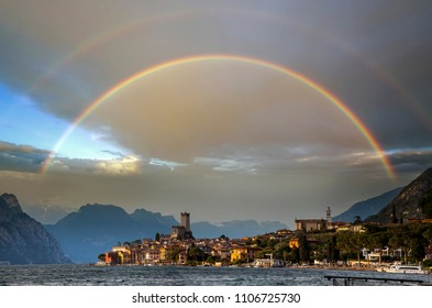 Town of Malcesine on Garda Lake in stuning sunset with rainbow, Veneto region of Italy