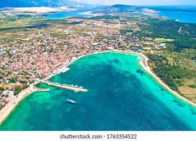 Town of Novalja beach and waterfront on Pag island aerial view, Dalmatia region of Croatia