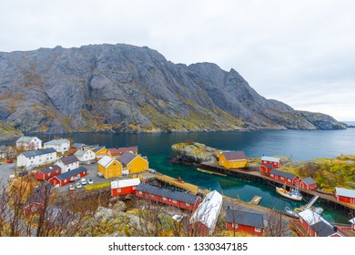 Town Nusfjord on Lofoten, Norway on Cloudy day in fall with traditional red fisher houses and boats