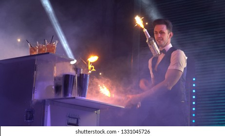Town of Olaine, Latvia - 23 of February 2019.  City birthday celebration in the forest park. A barman show on the open-air stage. The bartender juggling with bottles at the counter.