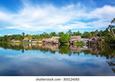 Town on the shore of the Yanayacu River in the Amazon rain forest near Iquitos, Peru