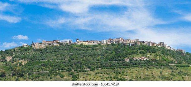 Town on the top of a hill in Italy touching the sky