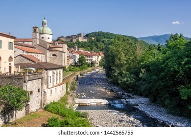 Town of Pontremoli in Lunigiana, Italy with the Magra river in the forefront and iconic buildings in the background.