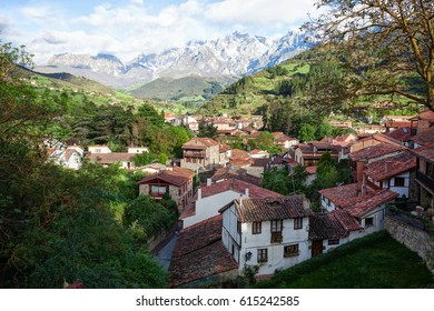 The town of Potes at  a sunny morning on a background of mountains, Cantabria,  Spain