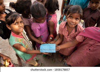 town puranpur, village bhaipur / India on 9th October 2020 village kids were playing with a face mask. during the pandemic of corona virus we are unable to provide masks in rural areas of india.