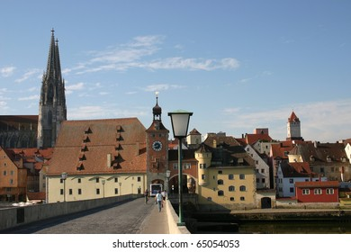 The town Regensburg and the old stone bridge across Danube