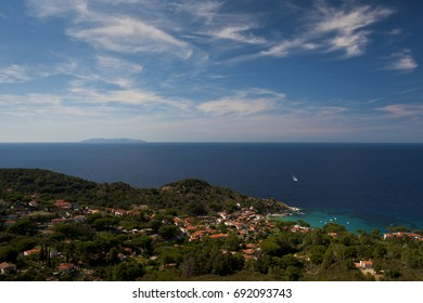 The town of Saint'Andrea overlooks the sea of the island of Elba, in the background the island of montecristo. Italy