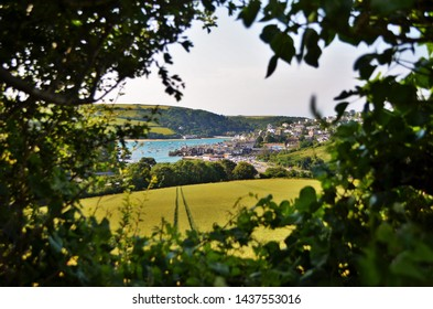 The town of Salcombe, Devon, viewed through a gap in a hedge.