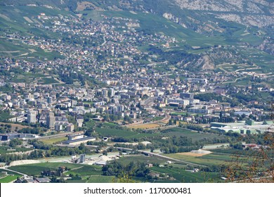 The town of Sierre in the canton of Valais, southern Switzerland with the River Rhone flowing in the foreground