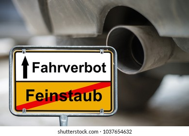 Town sign with the german words driving ban and fine dust