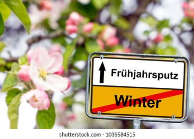 town sign with the german words spring cleaning and winter