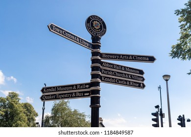 Town signpost showing directions to various places in the center of historical town Kendal. Kendal is considered as the southern gateway to the Lake District, UK