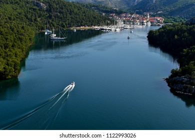 Town of Skradin on Krka river in Dalmatia, Croatia viewed from distance. Skradin is a small historic town and harbor.