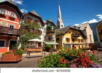 Town square in Hallstatt, Austria. Hallstatt Village Central Square with flowers and istoric architecture.