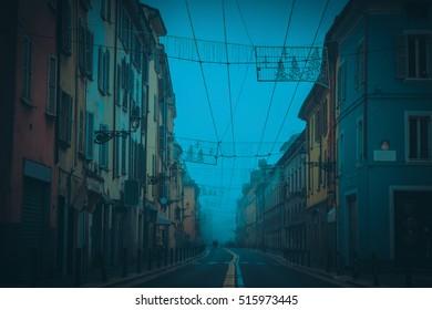 Town street in dark night. Parma, Emilia-Romagna, Italy.