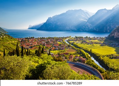 Town of Torbole and Lago di Garda sunset view, Trentino Alto Adige region of Italy