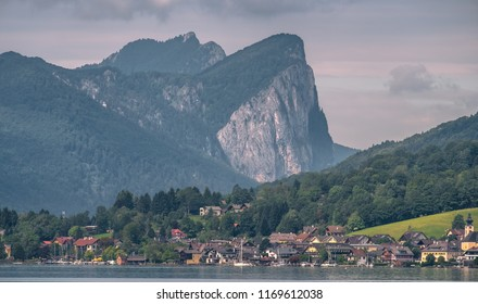 town unterach am attersee in front, mt. schafberg in background, seen from lake attersee in upper austria