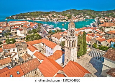 Town of Vela Luka on Korcula island church tower and coastline aerial view, archipelago of southern Dalmatia, Croatia
