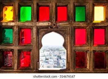 Town view from the colorful mosaic window in City Palace museum of Udaipur, Rajasthan, India