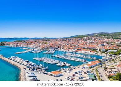 Town of Vodice, marina and turquoise coastline on Adriatic coast, aerial view, Croatia