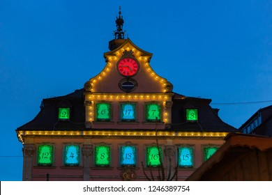 townhall christmas lights at market place in advent december blue hour sky in south germany