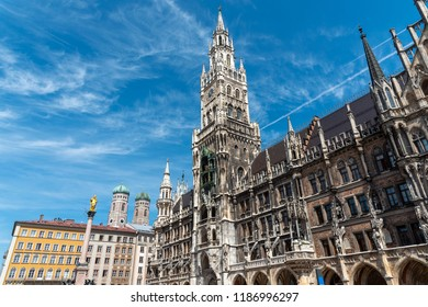 The townhall at the Marienplatz in Munich with the towers of the Frauenkirche in the back, Germany