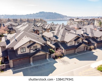 A townhouse complex with a view of the ocean in the background in North Vancouver, BC, Canada.