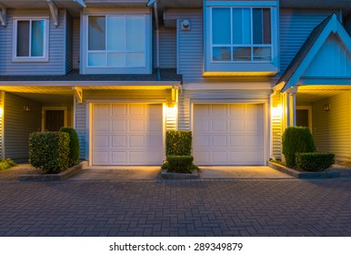 Townhouses, homes, community, garages at  dusk, night time in suburbs of Vancouver, Canada.