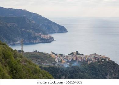 The towns of Corniglia and Manarola overlooking the Ligurian Sea in Cinque Terre, Italy.