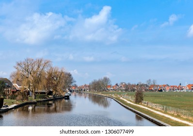 Townscape and canal in Hindeloopen, Friesland, Netherlands, Europe