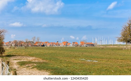 Townscape and field in Hindeloopen, Friesland, Netherlands, Europe