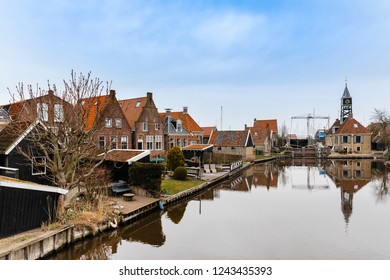 Townscape with old sluice and residential buildings in Hindeloopen, Netherlands.