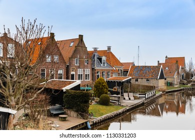 Townscape with residential buildings and canal in Hindeloopen, Netherlands.