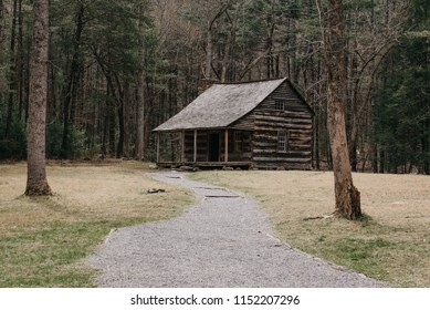 Townsend, TN / USA- 03 27 2018 : Landscape view of a cabin in the woods. Photo taken at Cades Cove National Park