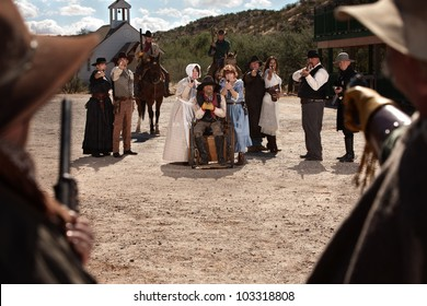 Townspeople under attack from bandits in old west scene