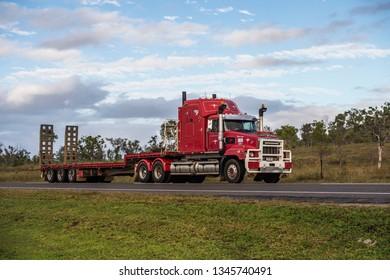 Townsville, Queensland, Australia - July 20 2016: Unloaded Low Loader Road Train travelling on Flinders Highway.