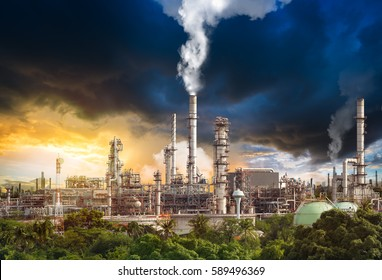 Toxic fumes pollution from industrial oil refinery smokestack in concept of global warming