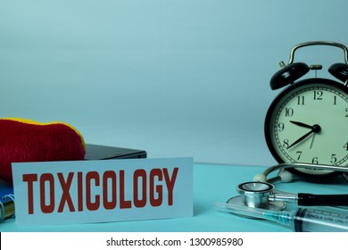 Toxicology Planning on Background of Working Table with Office Supplies. Medical and Healthcare Concept Planning on White Background