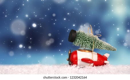 toy aircraft with christmas tree on snow