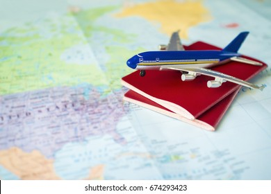 toy aircraft with two neutral passports on the map, travel concept, flight to america, trip by plane