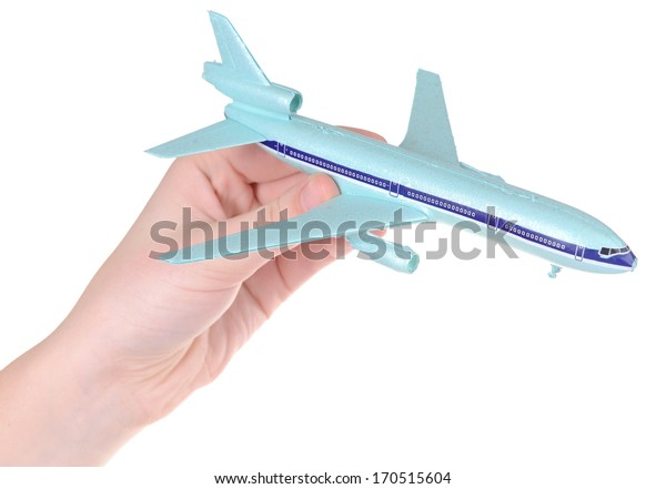 Toy airplane in hand isolated on white