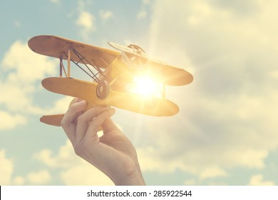 Toy airplane in hand - a symbol of travel and dreams