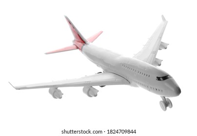 Toy airplane isolated on white. Travel concept