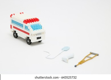 Toy ambulance car miniature on white background.