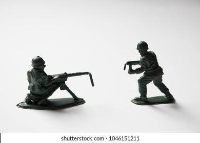 Toy army men with broken guns. Gun restriction, regulation and reform.