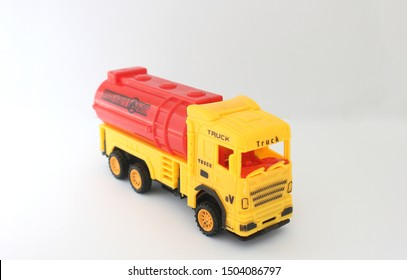 Toy truck yellow and red color isolated on white background.