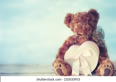 Toy bear with gift heart box