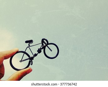 Toy bike and sky background, process vintage tone